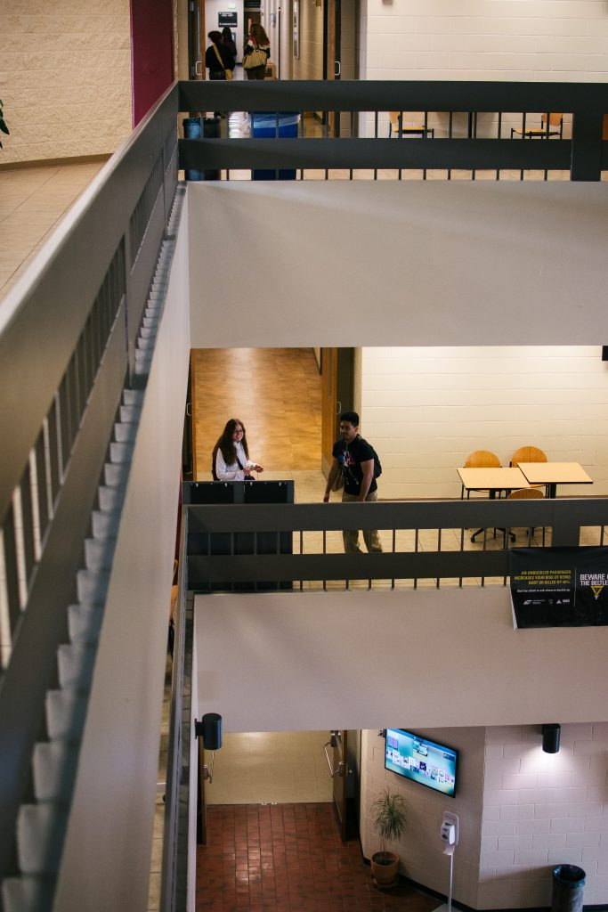 Students walk through the hallways on multiple levels at PPCC's Centennial campus.