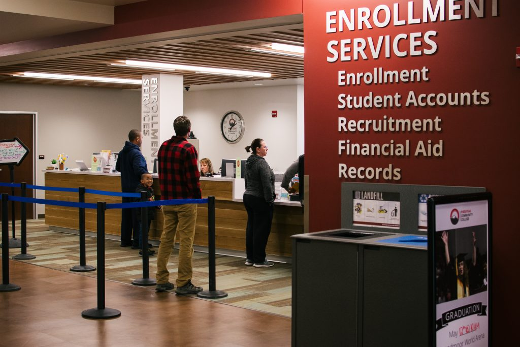 Students line up at Enrollment Services for assistance at PPCC's Centennial campus.