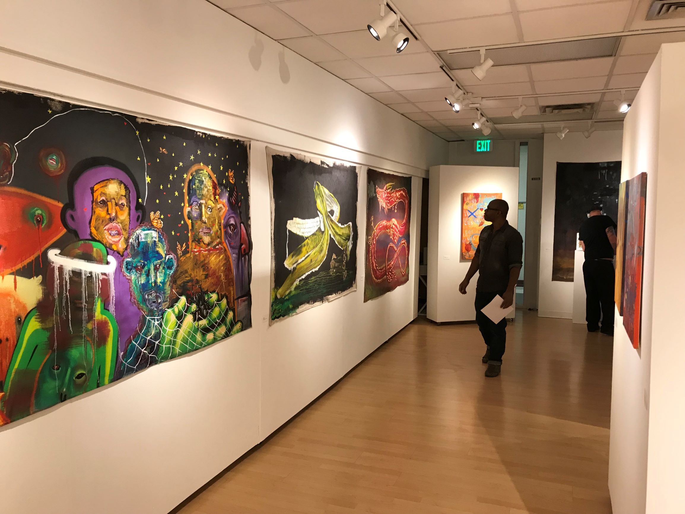 Preview of gallery featuring many paintings