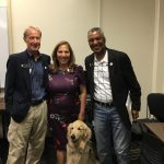 Local politicians Tony Exum, Yolanda Avila, and Senator Pete Lee stand with a golden retriever